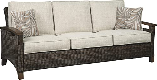 Signature Design by Ashley – Paradise Trail Outdoor Sofa with Cushions – All-weather Wicker Frame – Medium Brown