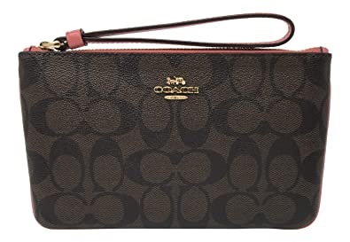 d166c8fe5b54 Image Unavailable. Image not available for. Color  Coach Signature PVC Large  Wristlet Brown Peony F58695
