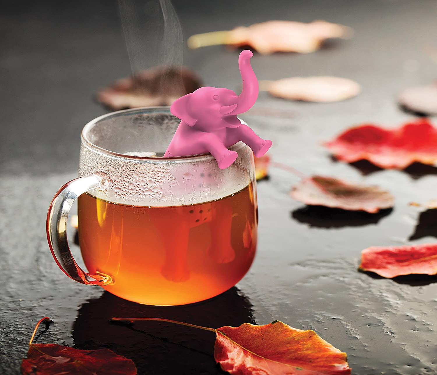 pink elephant silicone tea infuser in a cup of tea