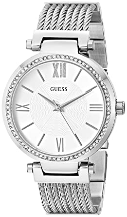 21c5852b49b9 Amazon.com  GUESS Stainless Steel Crystal Bangle Bracelet Watch with Self- Adjustable Links. Color  Silver-Tone (Model  U0638L1)  Watches