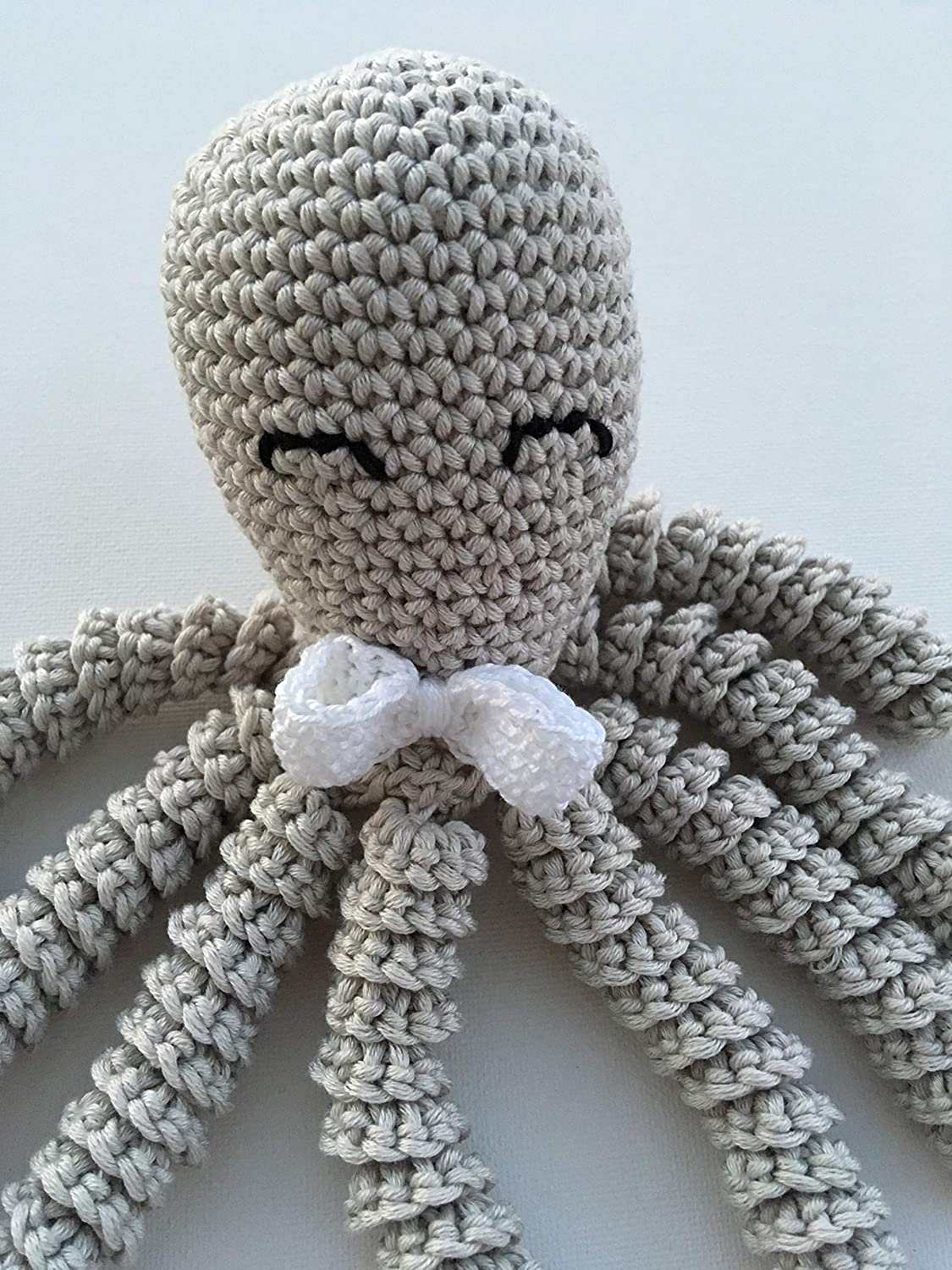 Hand knitted baby sensory octopus soft toys