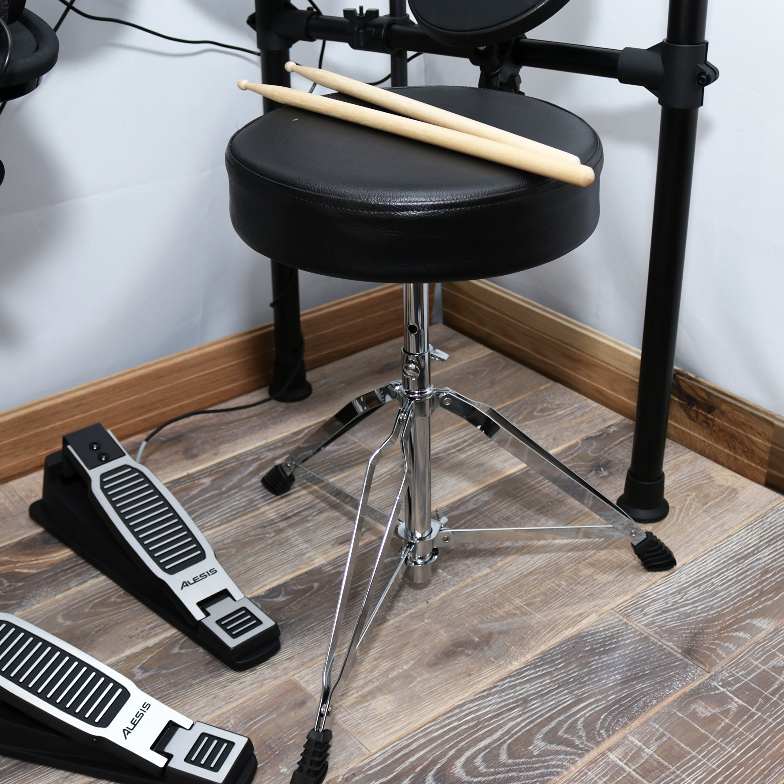 Alesis Seven-Piece Electronic Drum Burst Kit with DM6 Drum Module Includes Drum Throne, Drum Sticks, and FREE Headphones by Alesis