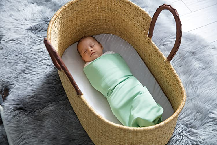 Natural moses basket baby