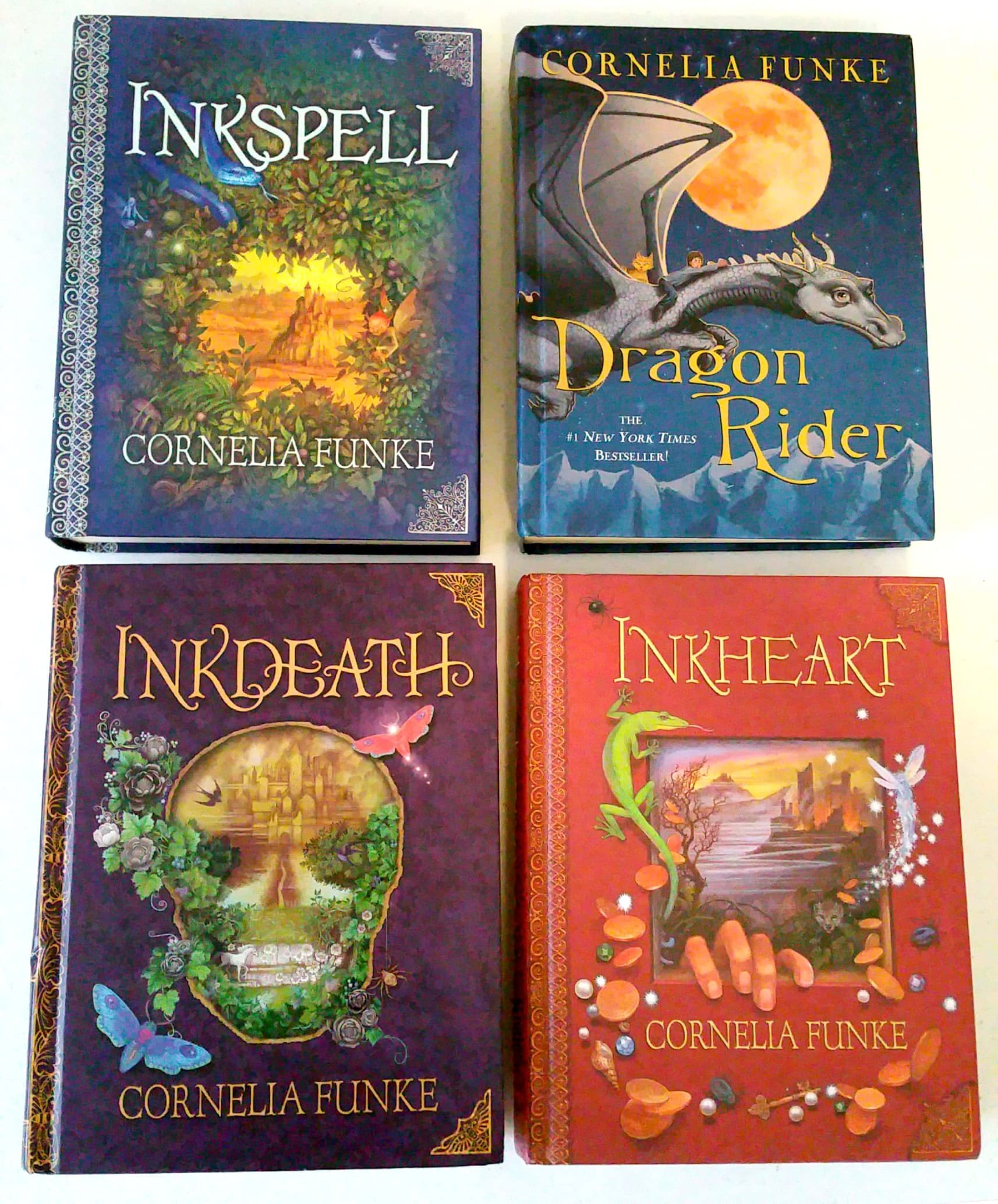 Set of 4 inkheart inkspell inkdeath dragon rider books cornelia set of 4 inkheart inkspell inkdeath dragon rider books cornelia funke amazon books fandeluxe Choice Image