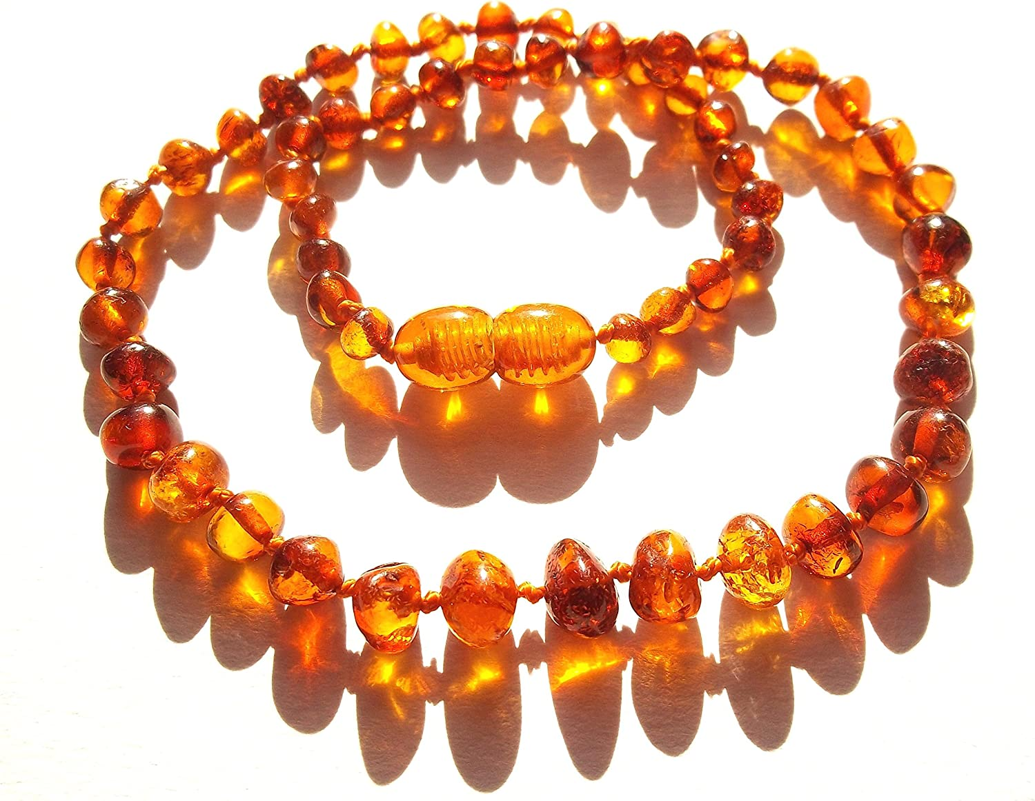 Amberta Collier Ambre 33cm 100/% Plus Haute Qualite Certifie lAmbre la Baltique Authentique Collier Perles