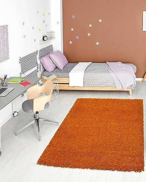 Amazon Com Ottomanson Shg2761 3x5 Solid Shag Rug 3 3 X 4 7 Orange Home Kitchen