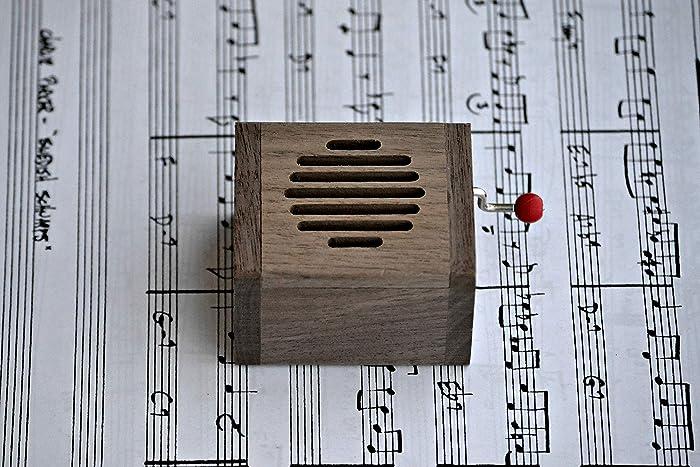 Caja de música manual de madera de calidad con distintas melodías de bandas sonoras