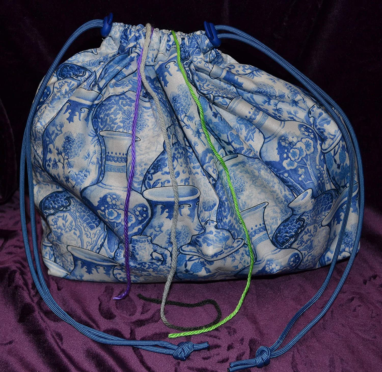 Purple knittedcrochet drawstring backpack