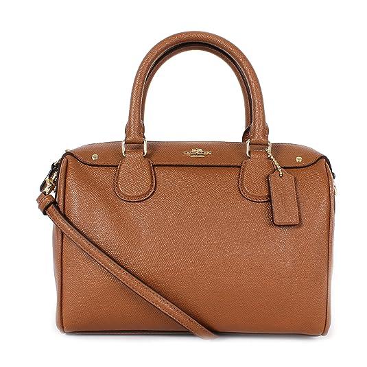 d0425bf01 Este bolso está fabricado con cuero cruzado resistente y cuenta con unas  cómodas dimensiones de 9 * 6 * 5 pulgadas. También, posee un bolsillo  interno con ...