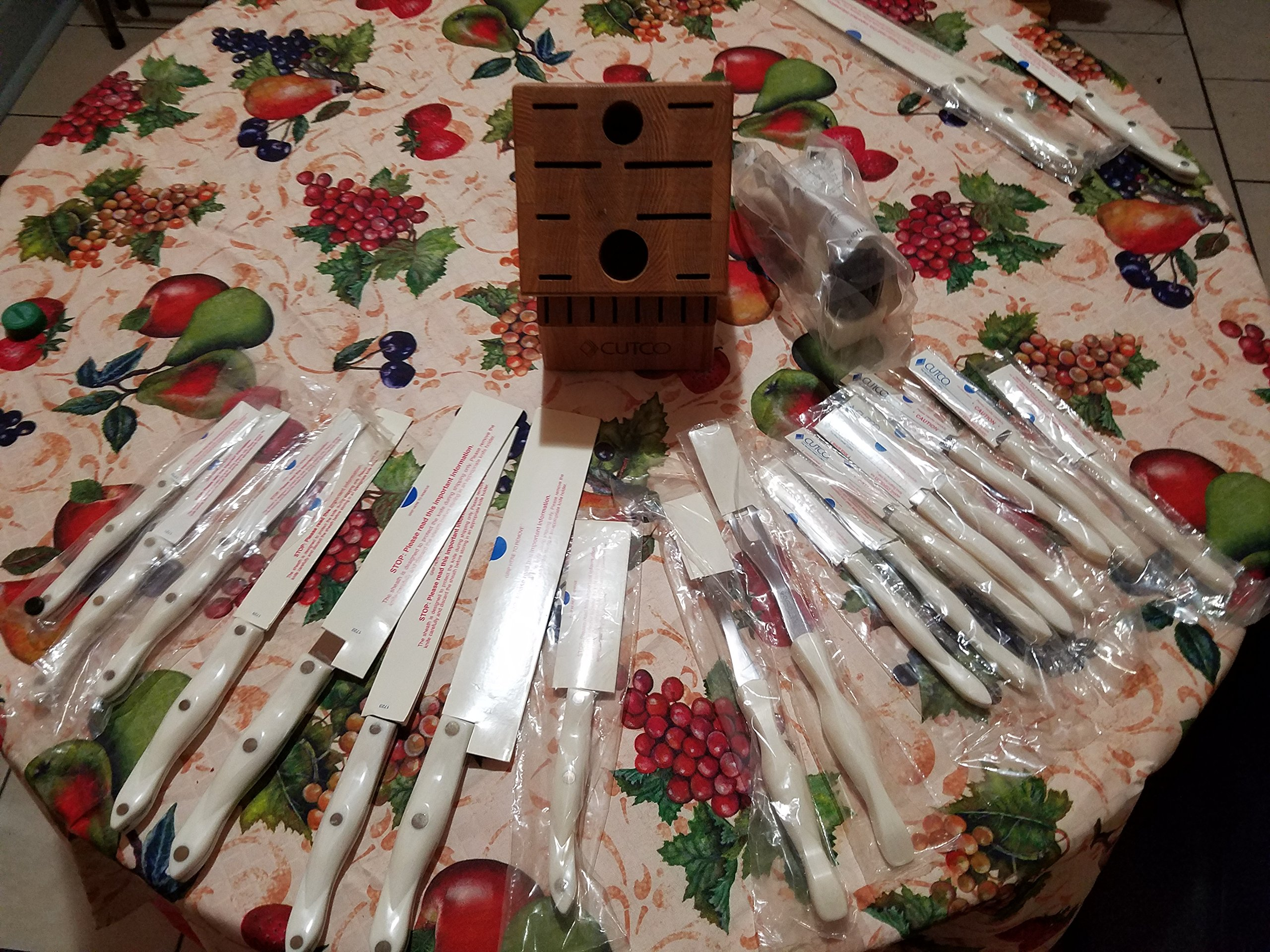 CUTCO Model 2018 White (pearl) Homemaker+8 Set............18 High Carbon Stainless knives & forks in factory-sealed plastic bags............#1748 Honey Oak knife block, #82 Sharpener, and #125 10'' x 13'' Poly Prep cutting board also included.