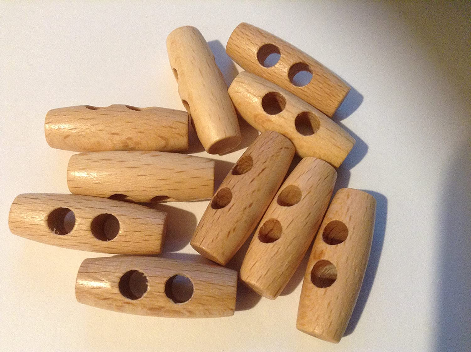 10 x 30mm wooden Toggle Button. Ideal for dressmaking and crafting. These toggles are two holes. Sew Many Buttons