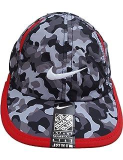 Amazon.com  Nike Girls Dri Fit Featherlight Cap  Clothing aed33bb17f13