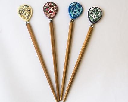 Pack de 4 palos de moño chino. Envío GRATIS 72h  Amazon.es  Belleza a6a28f3eb3a5
