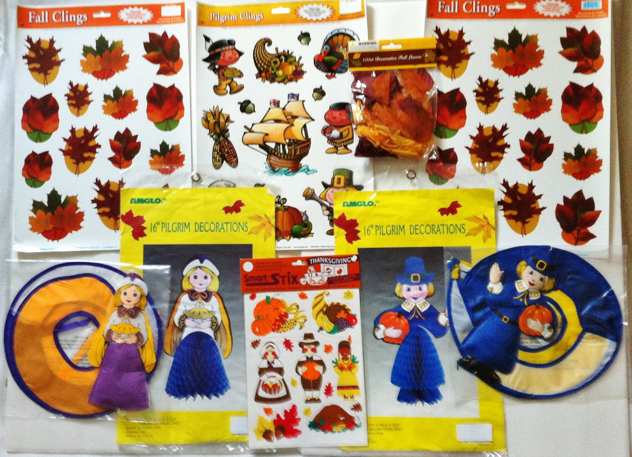 Bundle of 9 Thanksgiving Decorations: 4 Window Clings, 2 Pilgrim Honeycombs, 2 Wind Spirals, 1 Bag of Fall Leaves