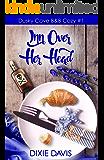 Inn Over Her Head (Dusky Cove B&B Cozy Mysteries Book 1)