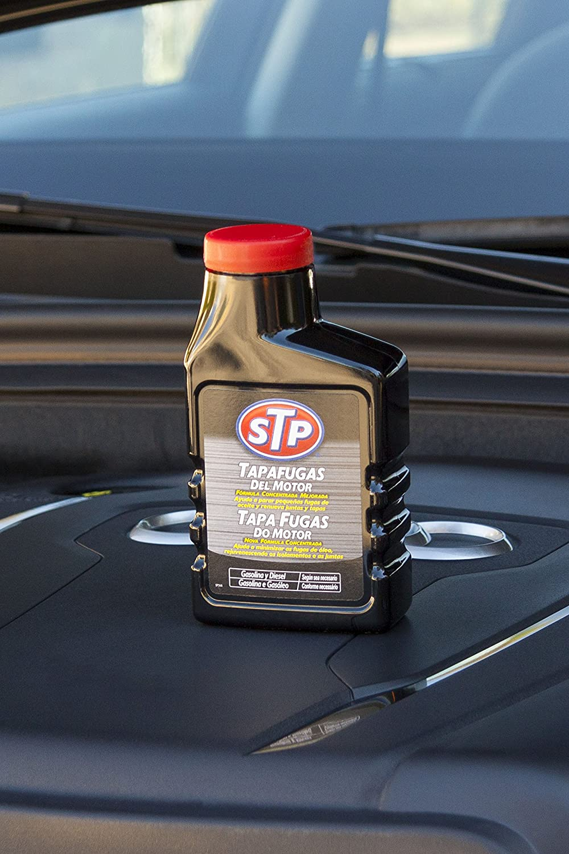 STP ST63300SP Tapafugas de Aceite Motores 300 ml: Amazon.es: Coche y moto