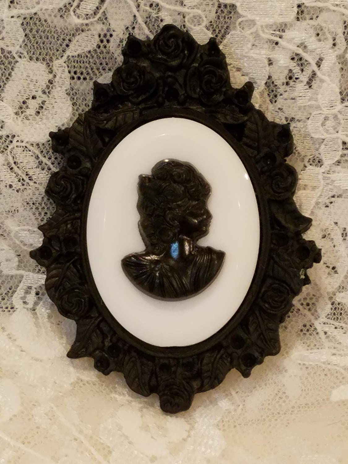 580f0a91f21 Amazon.com: Black and White Cameo Brooch in Black Resin Rose Frame: Handmade