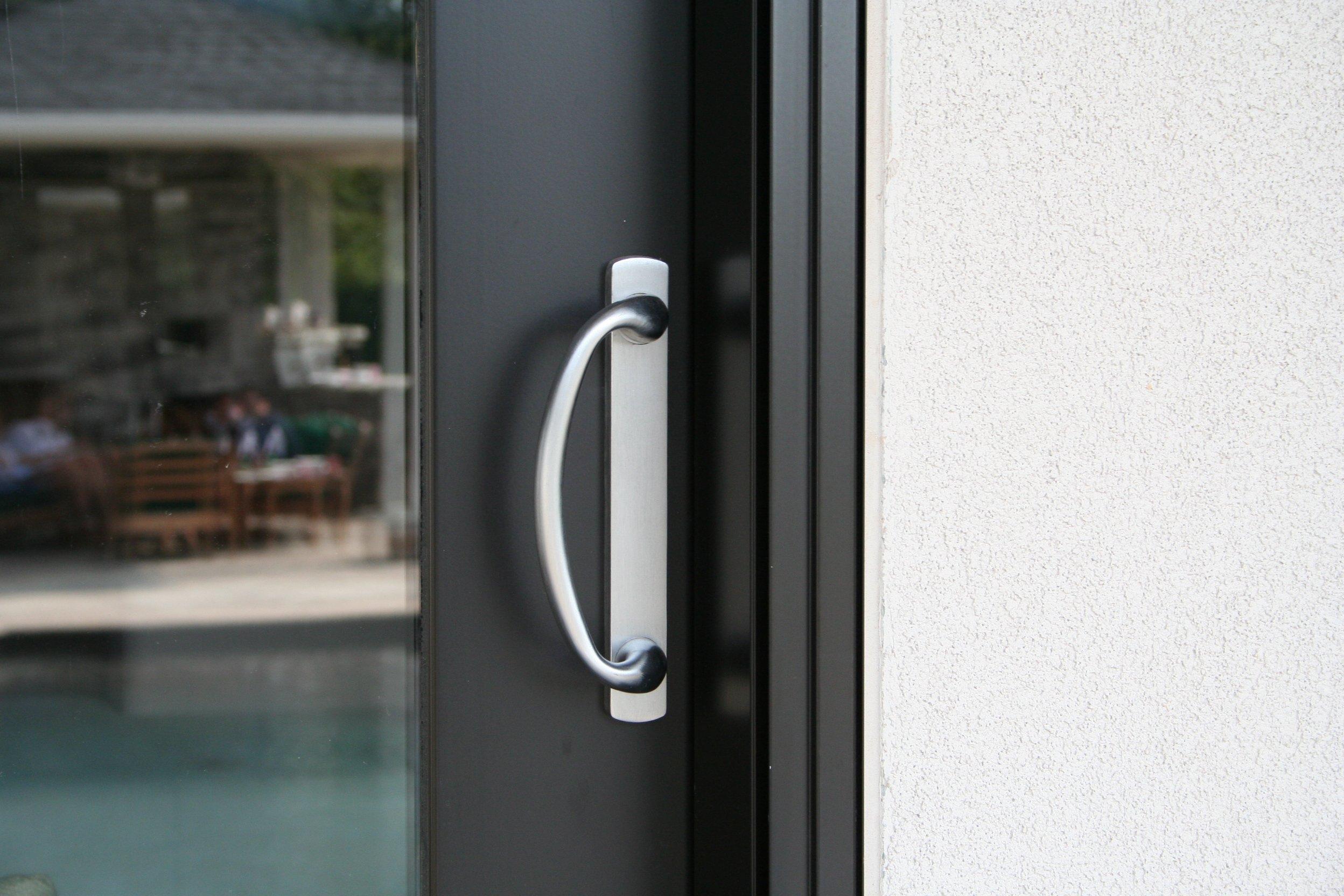 Rockwell Charlotte Sliding Door Handle Set in a brushed Chrome finish fits 1.5 inch to 1-3/4 inch doors with 3-15/16'' CTC Screwholes