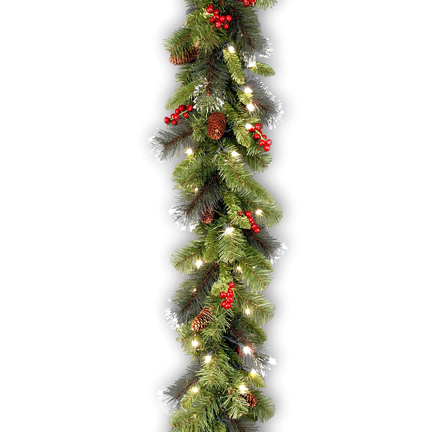 Amazon Com National Tree  Foot By  Inch Crestwood Spruce Garland With Silver Bristle Cones Red Berries And  Clear Lights Cwa  Home