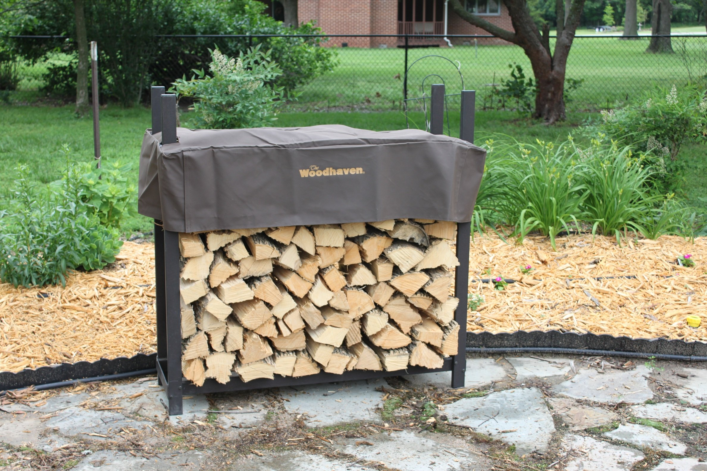 The Woodhaven 4 Foot Brown Outdoor Firewood Log Rack with Cover