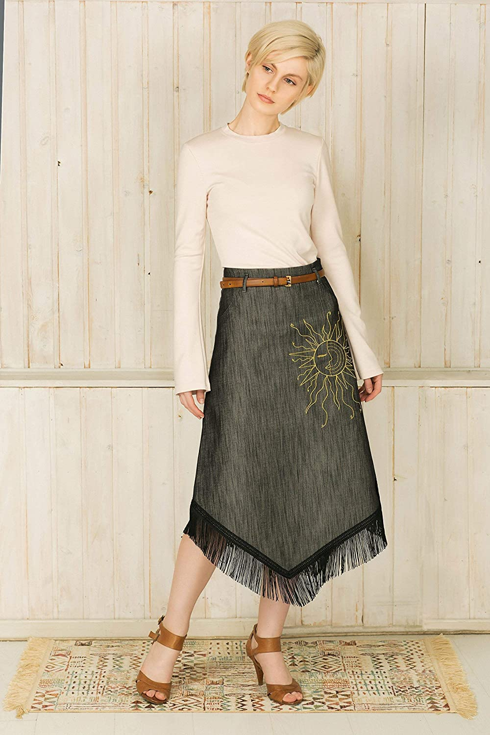 b834cc81759 A fringe-skirt is an ultimate style statement from your everyday look. Cut  from denim this high-waist midi skirt has tasseled fringing and an  asymmetric hem ...