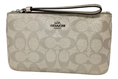 91ae6a961298 Image Unavailable. Image not available for. Color  Coach Metallic Signature  Coated Canvas Large Wristlet Platinum F39667