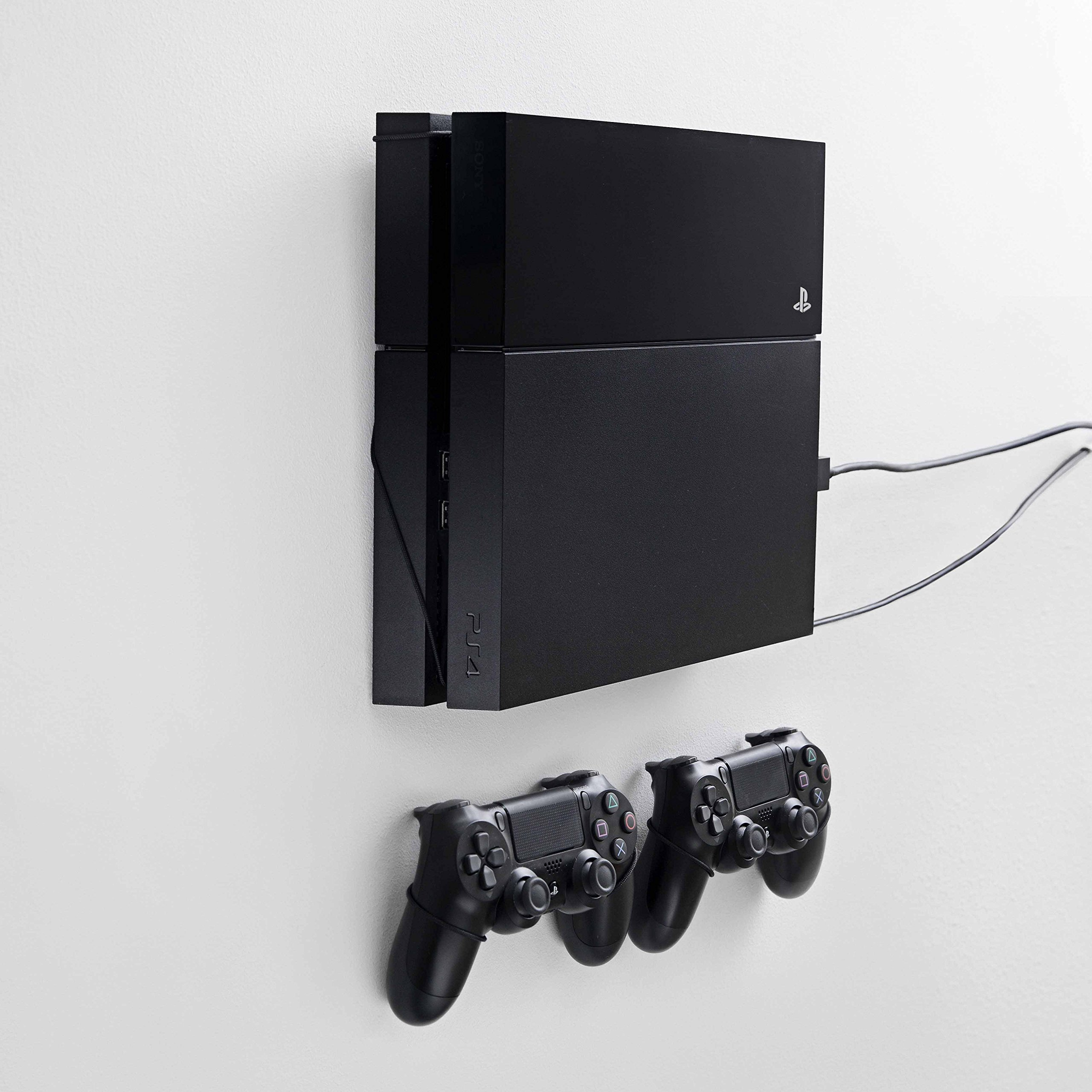 Wall mount for PS4 Original by FLOATING GRIP® - This package (BUNDLE) incl. mounts for 1x console and 2x controllers. Color: Black. Patent pending and proprietary design by FLOATING GRIP®