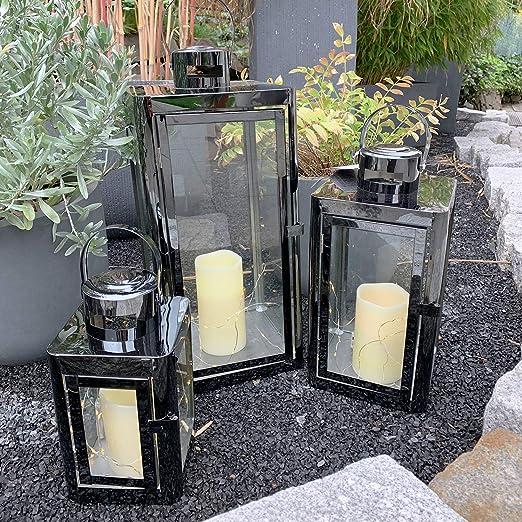Mojawo - Juego de 3 faroles de jardín de Acero Inoxidable, Color Plateado, Altura 22/32/46 cm, diseño Elegante, Incluye 3 Cadenas de luz + 3 Velas LED: Amazon.es: Hogar