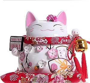 Maneki Neko - afortunado japonés del gato de porcelana con