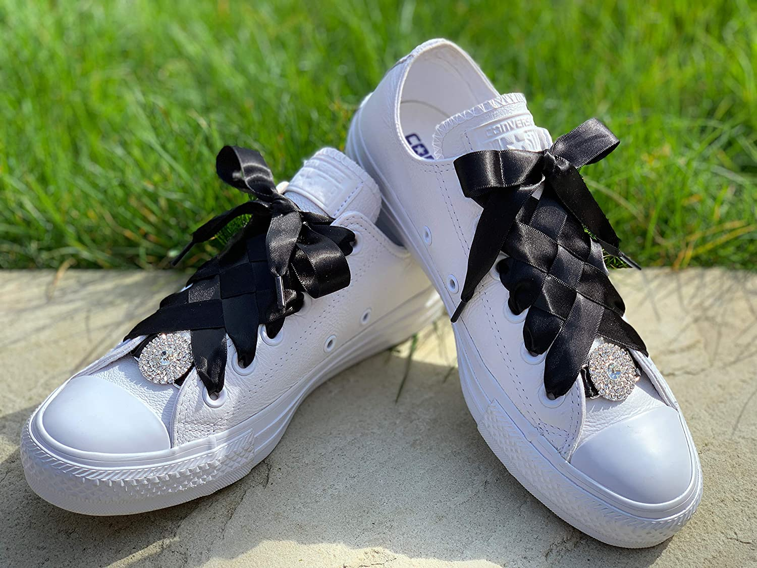 black trainers with ribbon laces