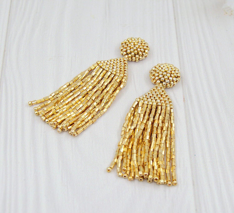 Yellow gold beaded cotton tassel earrings