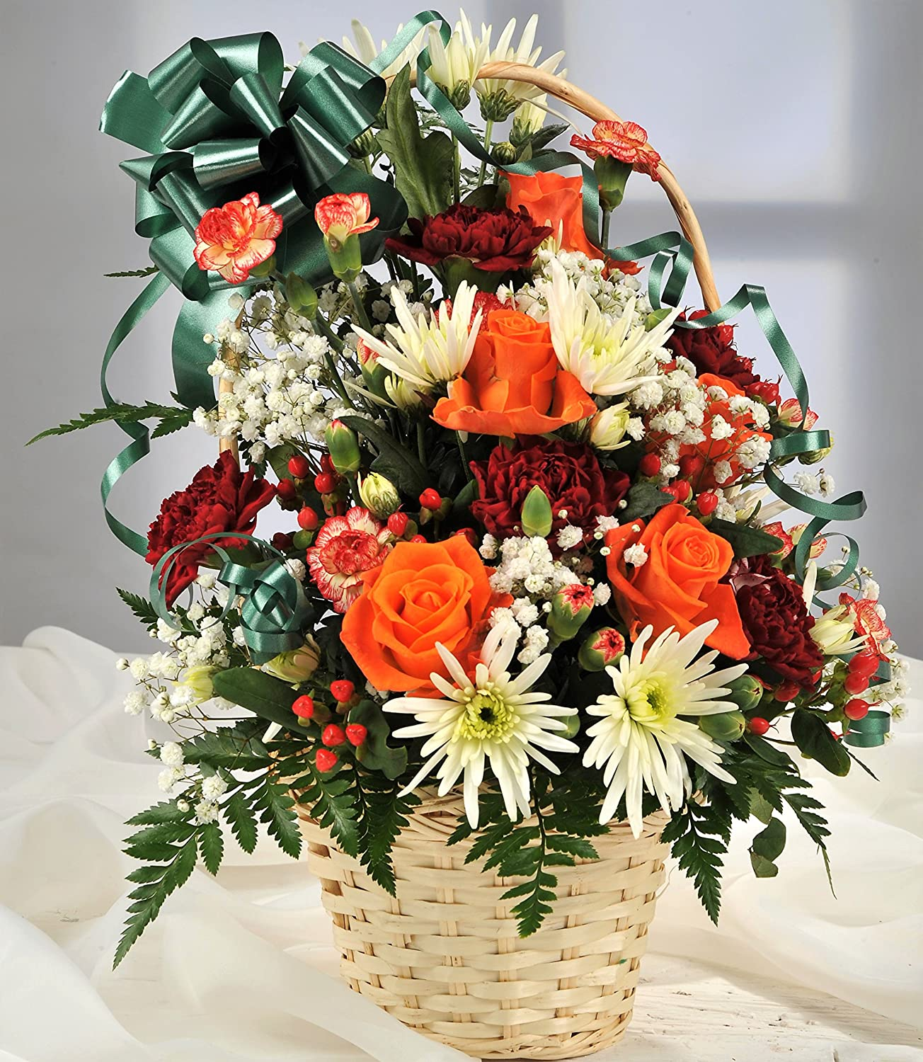 Autumnal Red & Orange Cut Flower Arrangement in Wicker Basket with Handwritten Gift Card - Fresh Flowers Delivered - FREE UK Next Day Delivery in 1hr Time-Slot 7 Days a Week - Front Facing Arrangement Homeland Florists