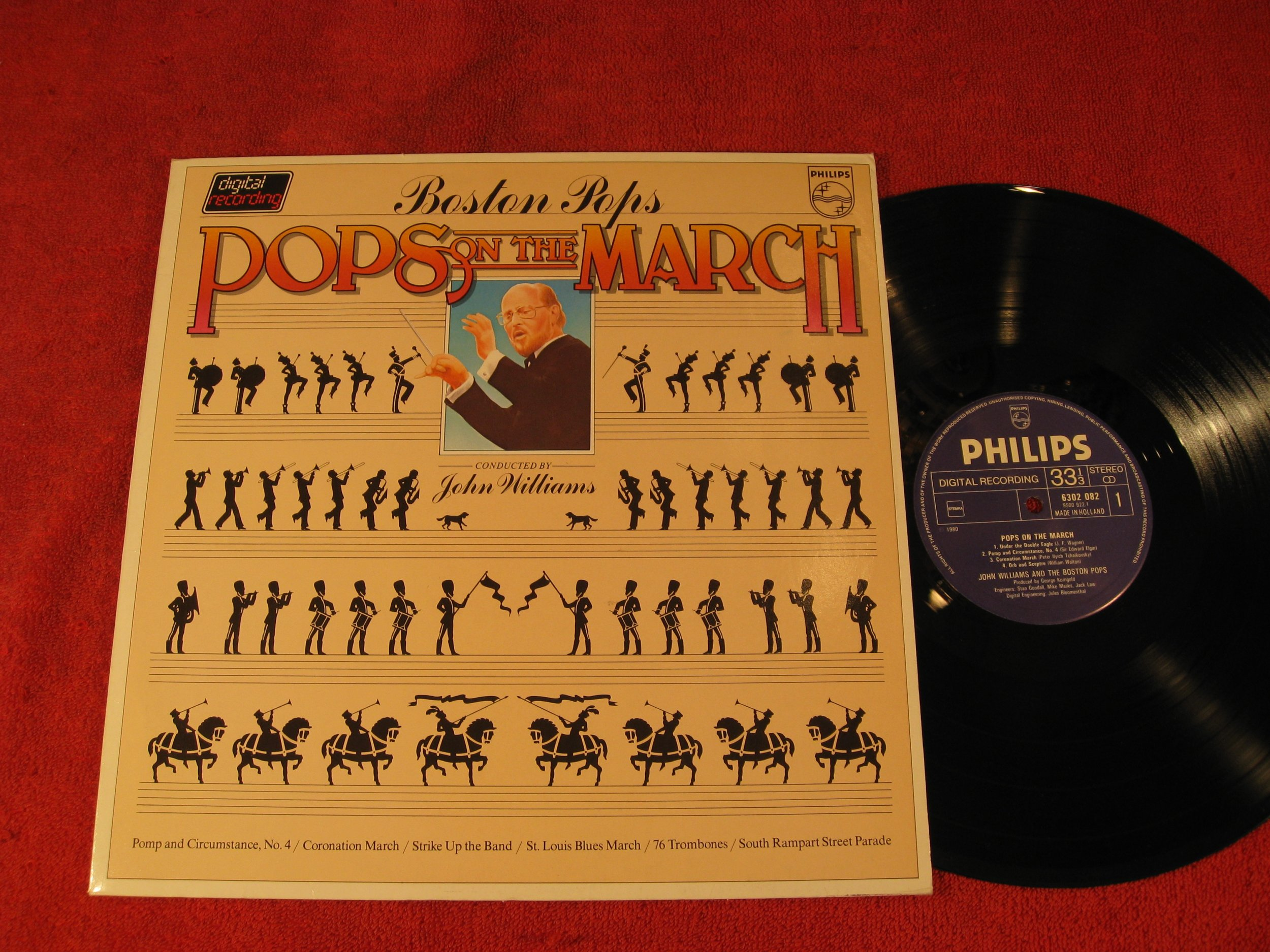 Pops on the March; Boston Pops; John Williams; Pomp and Circumstance no. 4; Coronation March; Strike up the Band; St. Louis Blues March; 76 Trombones; South Rampart Street Parade; 1980 Vinyl LP