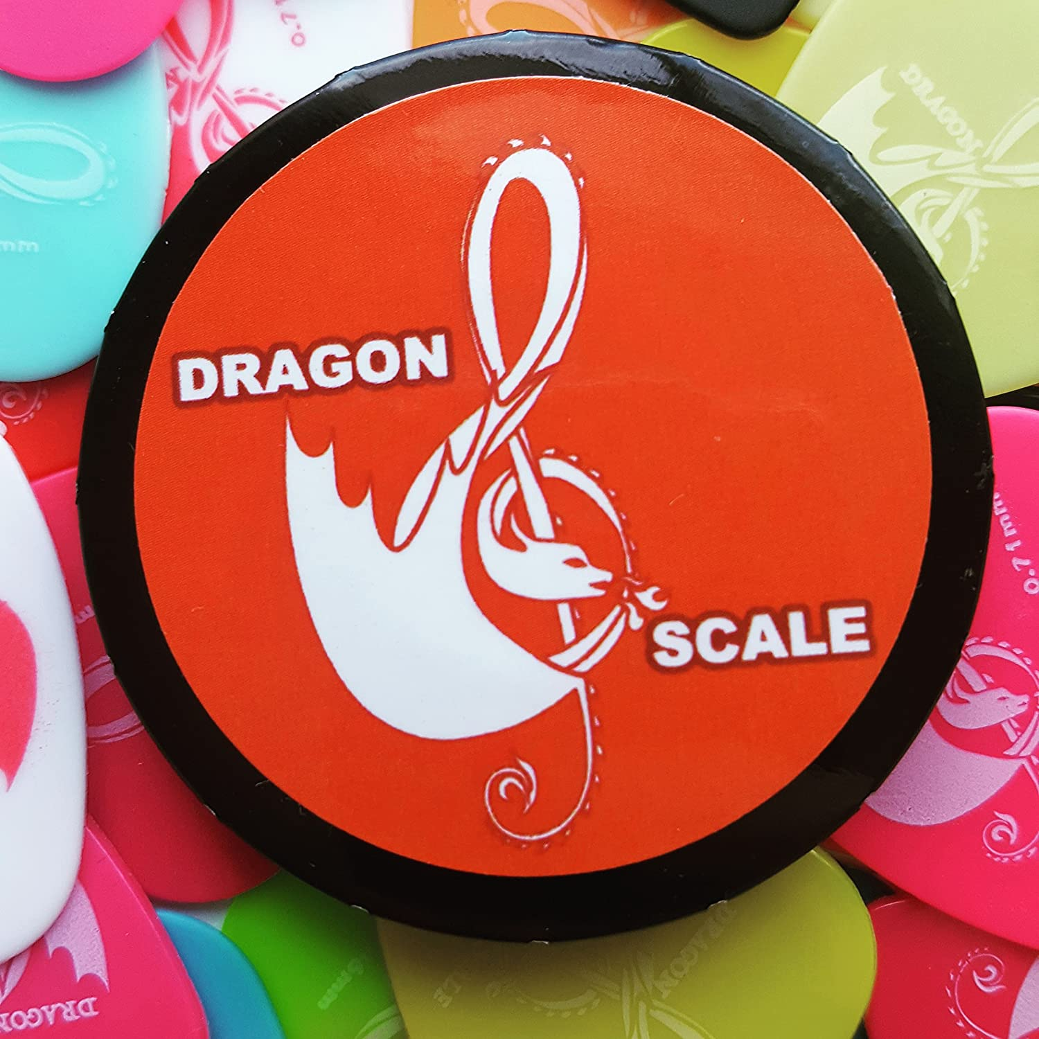 Guitar pick pack- 10 Picks in a Dragon Scale Click-Clack Pick-Pack. Pick packs come in a range of sizes: .46mm.71mm.88mm, 1mm, 1.2mm or our Variety pack. (.88mm) Ltd. DSCCPP1