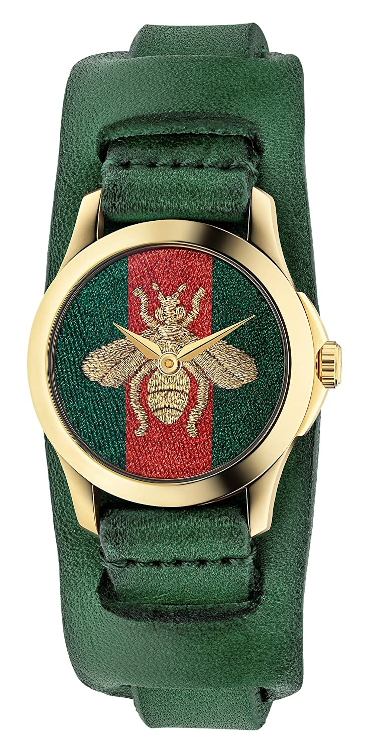 97d062a693a Red and green nylon dial with gold-tone hands. Dial Type  Analog. Quartz  movement. Scratch resistant sapphire crystal.