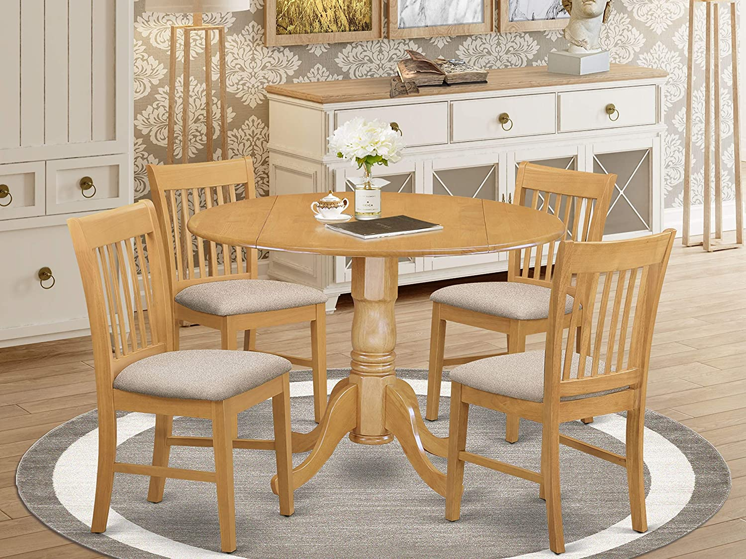 East West Furniture DLNO5-OAK-C 5-Piece round dining table set Oak finish- Two 9-inch Drops Leave and Pedestal Legs small table & 4 Slatted Back mid century dining chairs