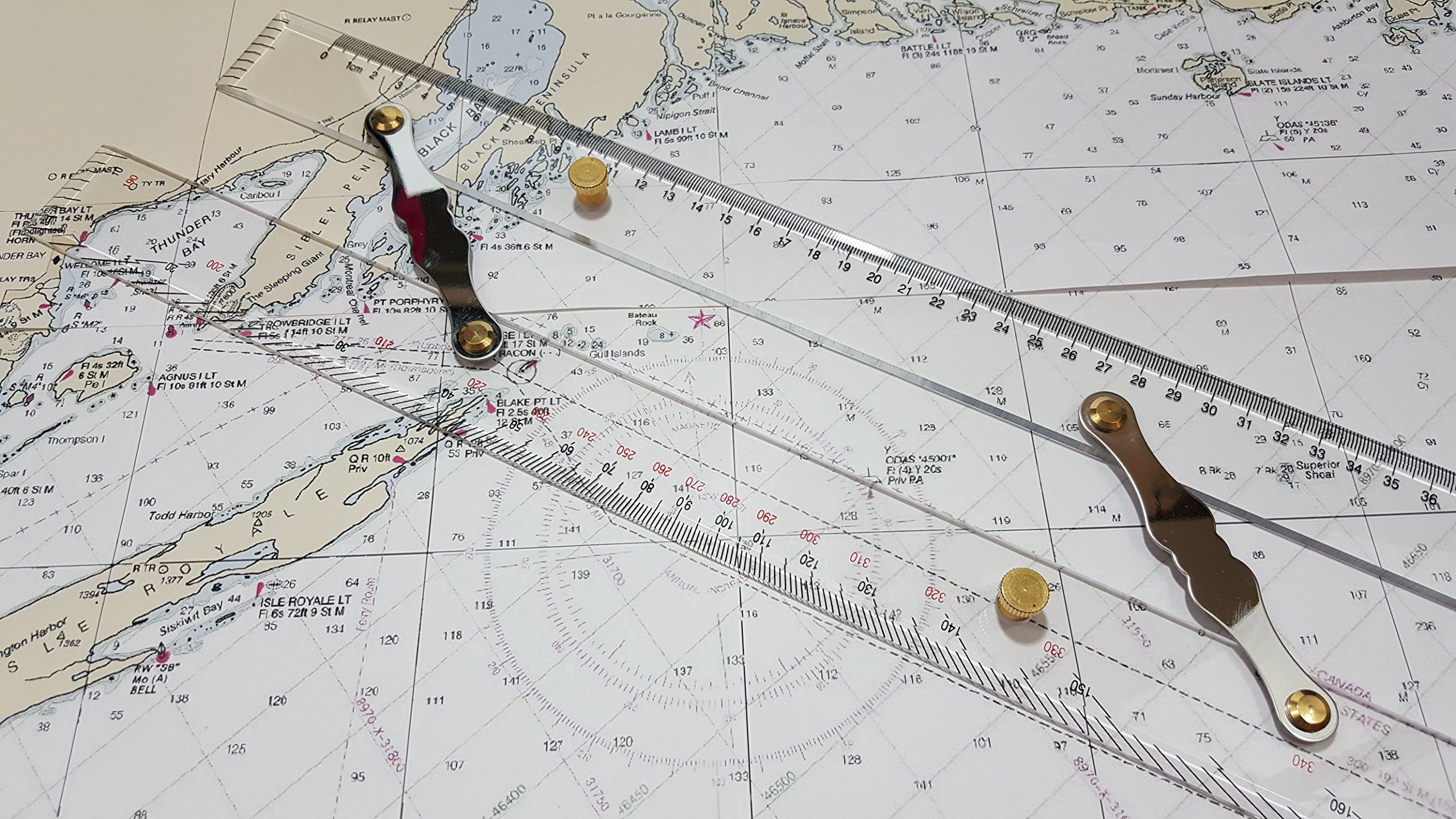 Parallel Ruler by Ferocious Viking for Navigation on Sea Charts with Ruler and Protractor Scales and brass buttons, aluminium links and transparent acrylic plastic for accurate chart plotting