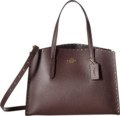 647f52cae73c COACH Women s Border Rivets Charlie Carryall B4 Oxblood One Size  Handbags   Amazon.com