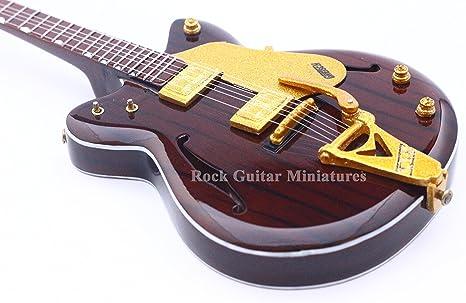 RGM10 George Harrison Beatles Guitarra en miniatura: Amazon.es ...