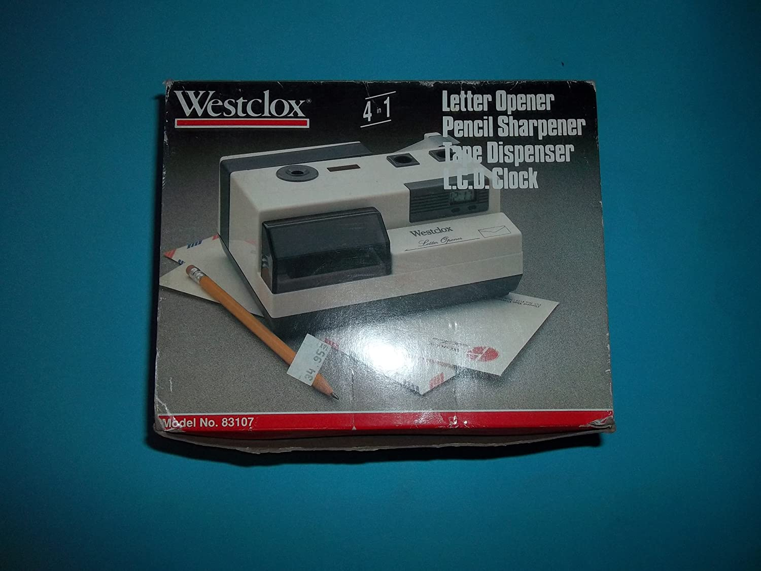 Westclox 83107 4 in 1 Letter Opener Pencil Sharpener Tape Dispenser LCD Clock Battery Operated Can Use AC Made in China
