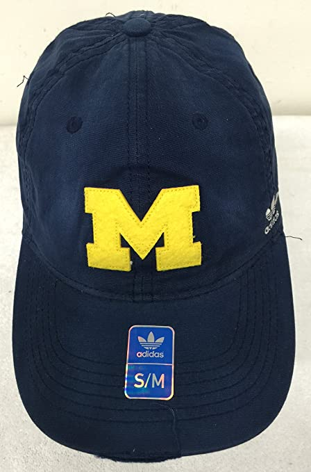 f01fc53c514f0 Amazon.com   adidas Michigan Wolverines Distressed Navy Slouch Flex Hat Cap  Fitted S M   Sports   Outdoors