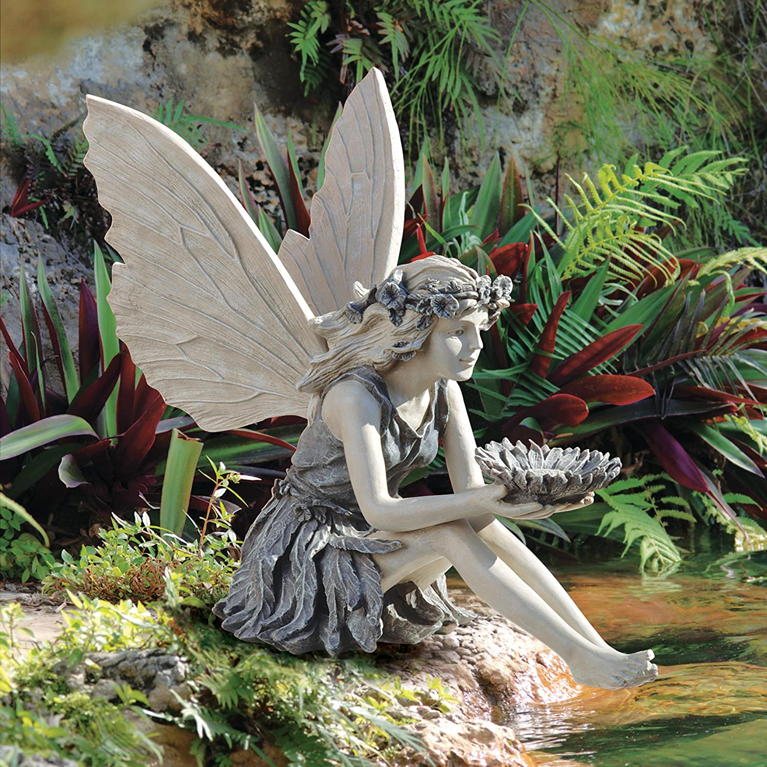 collectible fairy statue with sunflower bowl