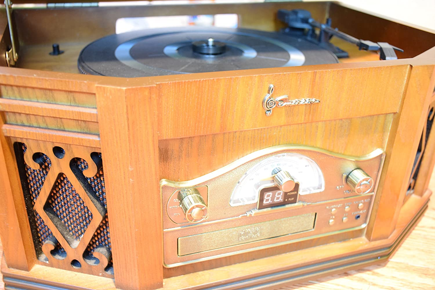 Amazon.com: Emerson EME NR303TTC 4 In 1 Vintage Classic Turntable Real Wood  Stereo System With AM/FM Radio, CD, Cassette Tape, And Full Size Record  Player ...