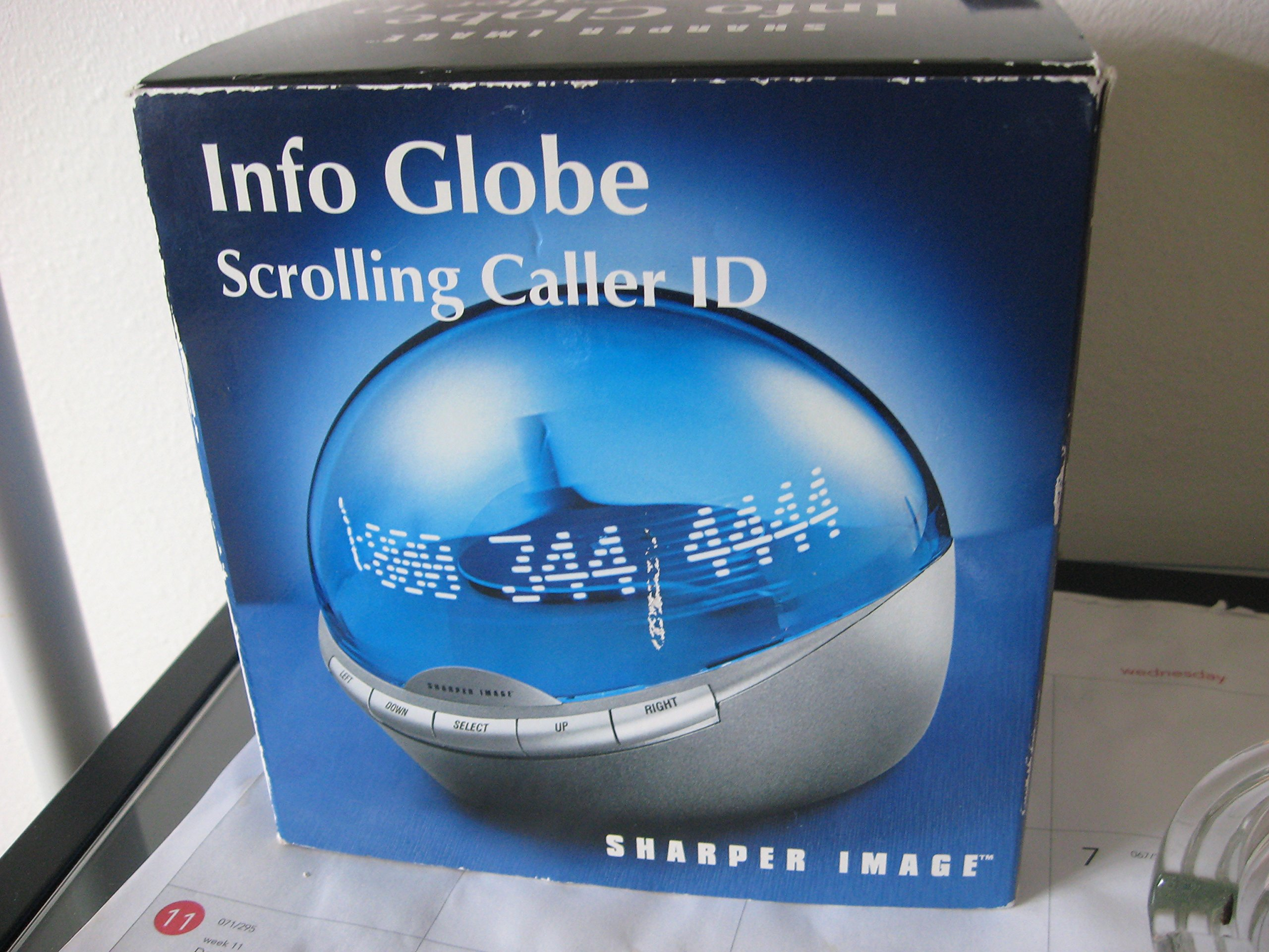 Sharper Image Info Globe Scrolling Caller ID by Sharper Image