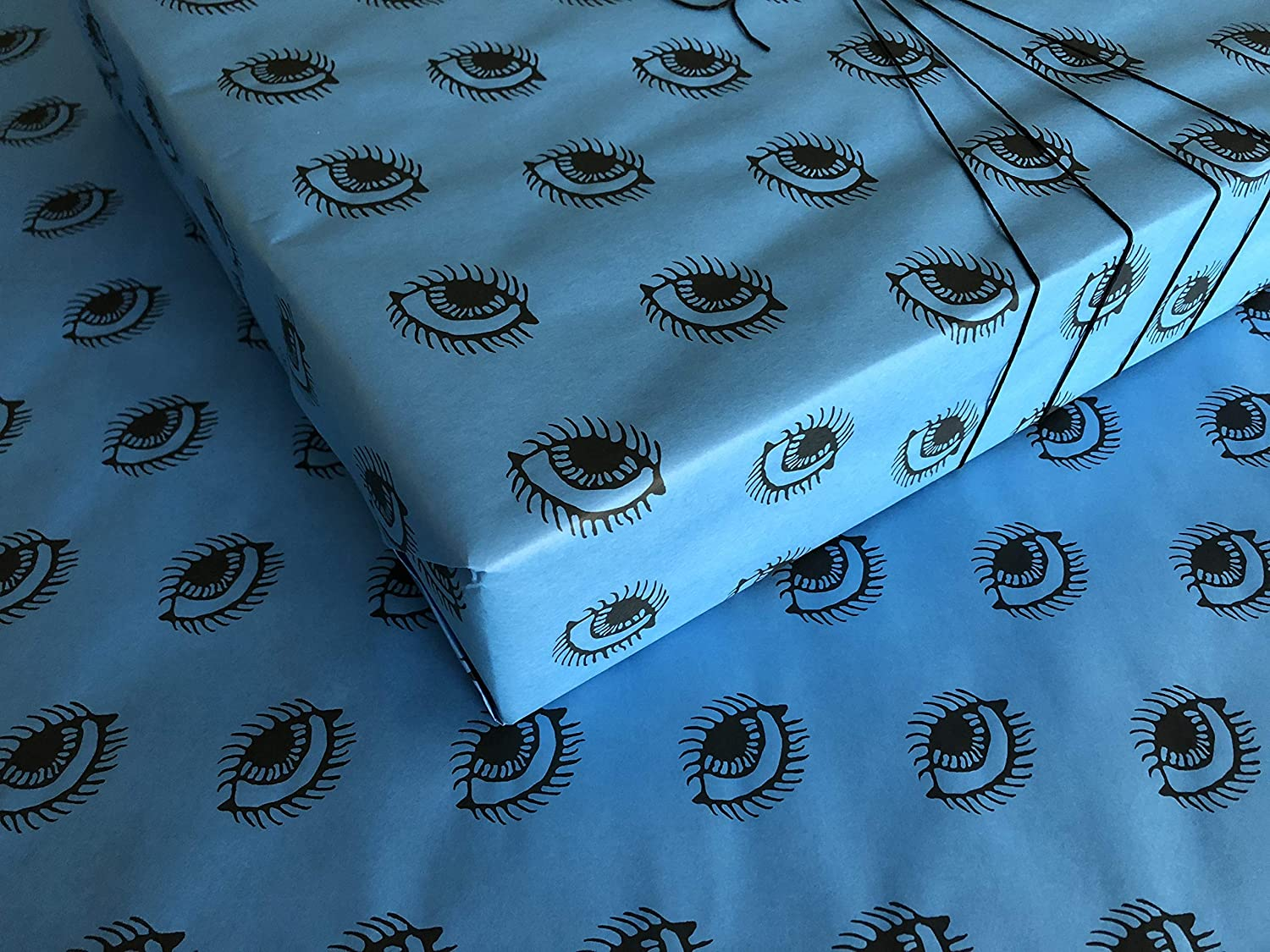 Roll of Spooky Eyes on Blue Gothic Wrapping Paper Who wouldn't love to have their Christmas gifts covered in eyes? Rebel against the ordinary and make your ...