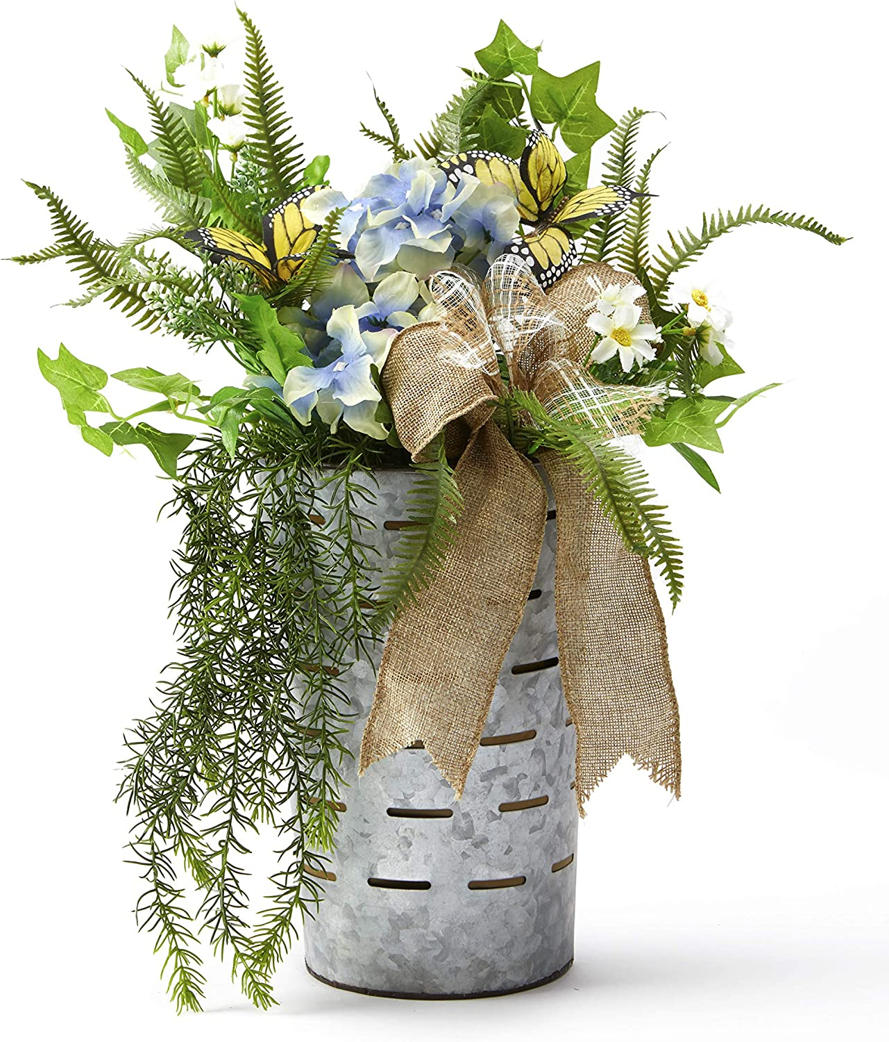 Floral arrangement with blue bird nest blue and green theme with old time wire basket large lettuce leaves floral hydrangea basket