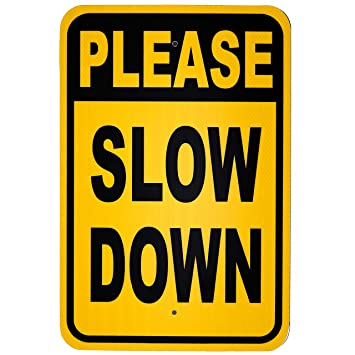 Image result for slow down sign