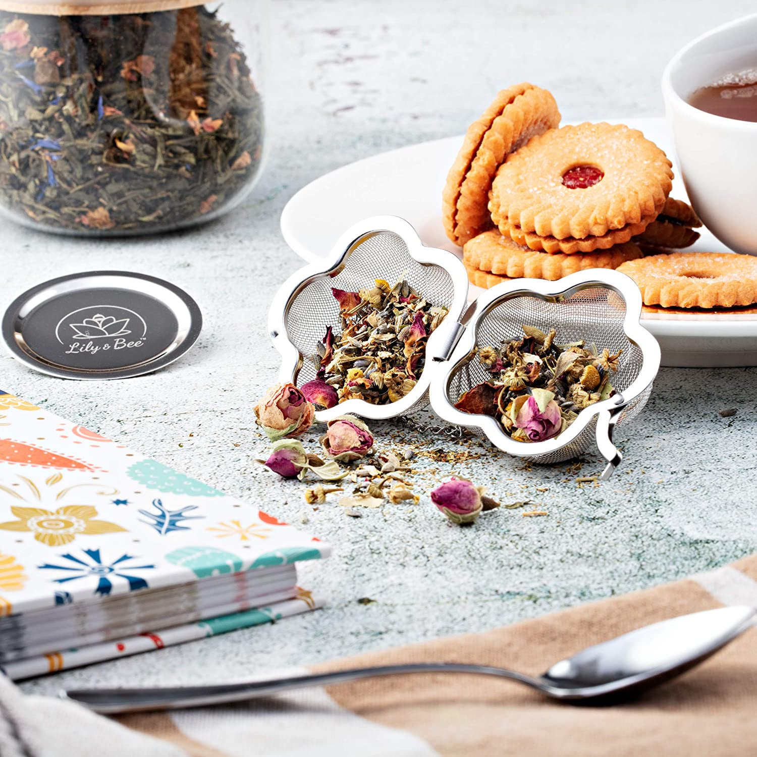 Unique Flower Shape Reusable Tea Infuser Ball for Loose Leaf Tea Cute Tea Gift Set Perfect for all Occasions Fine Mesh Stainless Steel Single Serve Strainer and Steeper with Charming Drip Tray