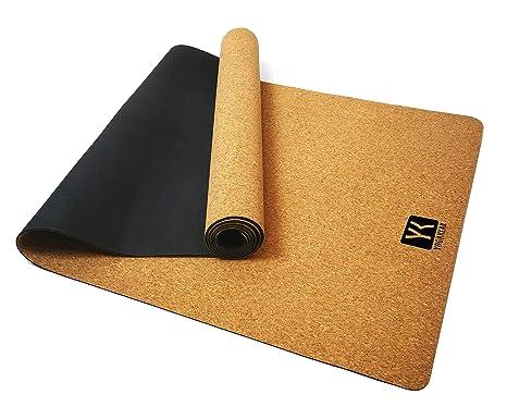 Esterilla antideslizante premium para yoga, incluye una práctica correa de transporte. Hecha de corcho y caucho natural y de fácil cuidado. Materiales ...