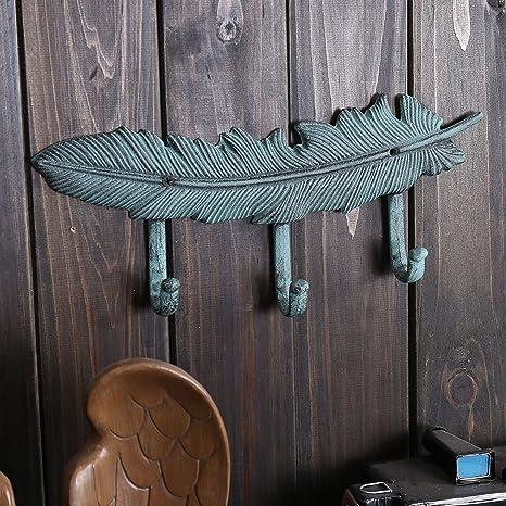 Amazon.com: Ganchos de hierro fundido para colgar en la ...